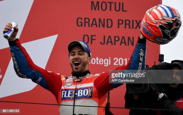 MotoGP class winner Ducati rider Andrea Dovizioso of Italy celebrate his victory on the podium during the MotoGP Japanese Grand Prix at Twin Ring...