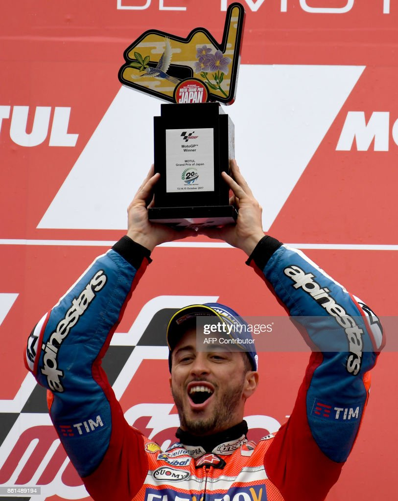 MotoGP class winner Ducati rider Andrea Dovizioso of Italy raises his trophy on the podium during the MotoGP Japanese Grand Prix at Twin Ring Motegi circuit in Motegi, Tochigi prefecture on October 15, 2017. /