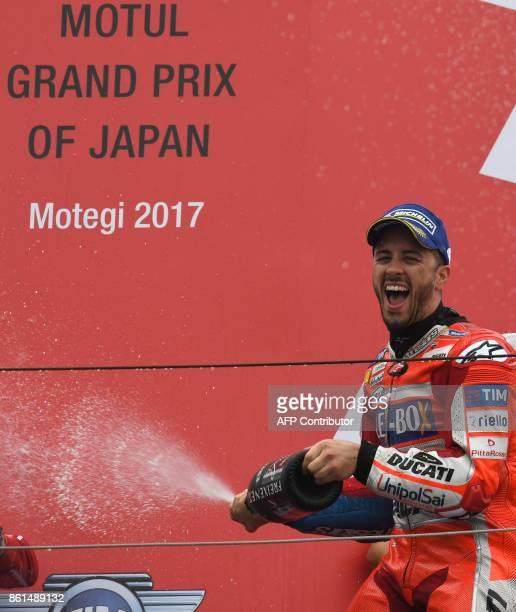 MotoGP class winner Ducati rider Andrea Dovizioso of Italy sprays champagne on the podium during the MotoGP Japanese Grand Prix at Twin Ring Motegi...