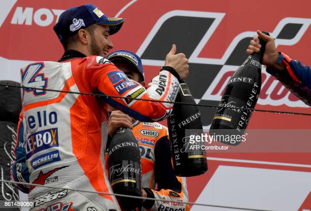 MotoGP class winner Ducati rider Andrea Dovizioso of Italy toasts with champagne on the podium during the MotoGP Japanese Grand Prix at Twin Ring...