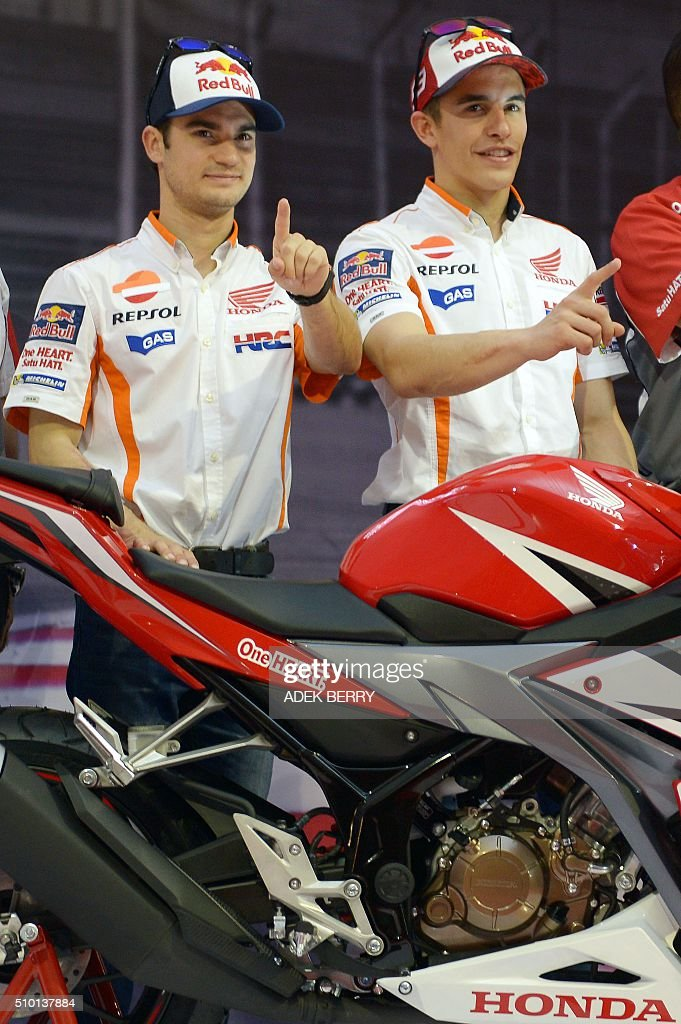 MotoGP motorcycle riders Marc Marquez (R) and Dani Pedrosa (L) of Spain gesture as they attend the launch of the new Honda CBF150R bike at the Sentul International Circuit in Bogor on February 14, 2016. AFP PHOTO / ADEK BERRY / AFP / ADEK BERRY