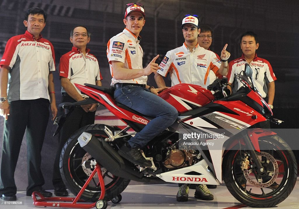 MotoGP motorcycle riders Marc Marquez (C-on bike) and Dani Pedrosa (2nd R) of Spain gesture as they attend the launch of the new Honda CBF150R bike at the Sentul International Circuit in Bogor, Indonesia, on February 14, 2016.