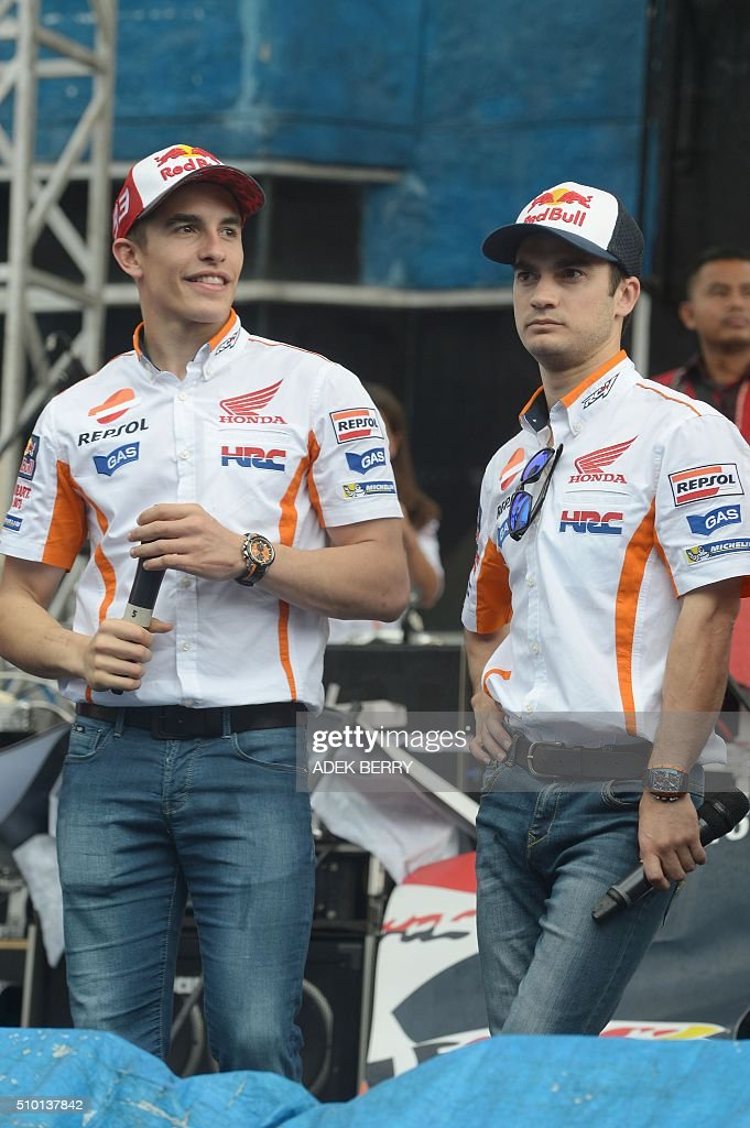 MotoGP motorcycle riders Marc Marquez (L) and Dani Pedrosa (R) of Spain attend the launch of the new Honda CBF150R bike at the Sentul International Circuit in Bogor on February 14, 2016. AFP PHOTO / ADEK BERRY / AFP / ADEK BERRY