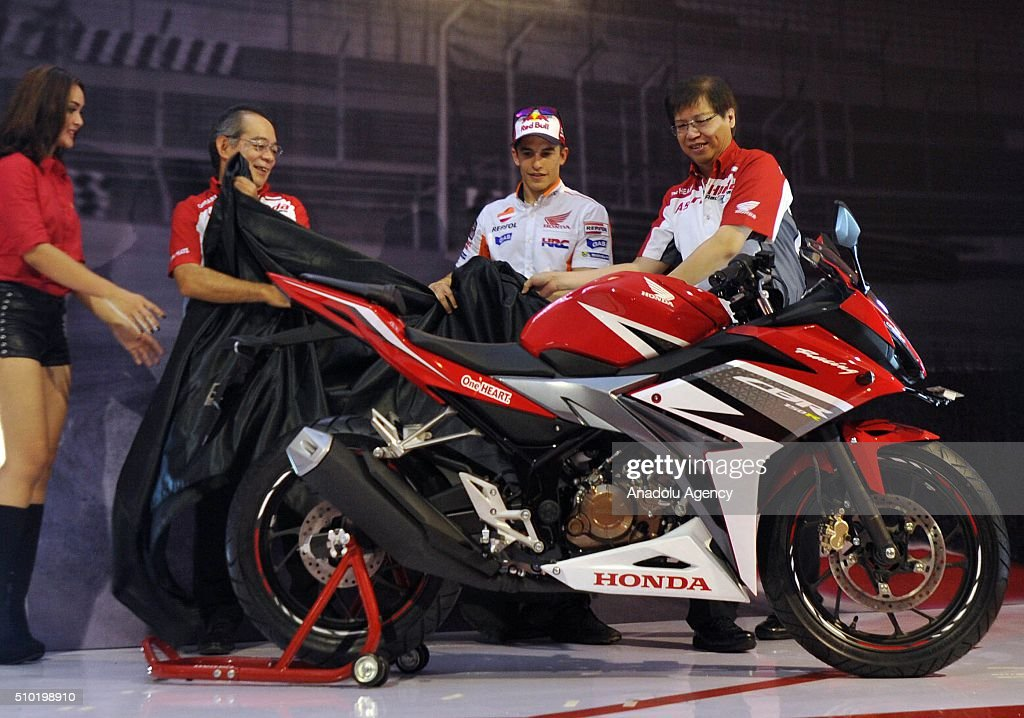 MotoGP motorcycle riders Marc Marquez of Spain gesture as they attend the launch of the new Honda CBF150R bike at the Sentul International Circuit in Bogor, Indonesia, on February 14, 2016.