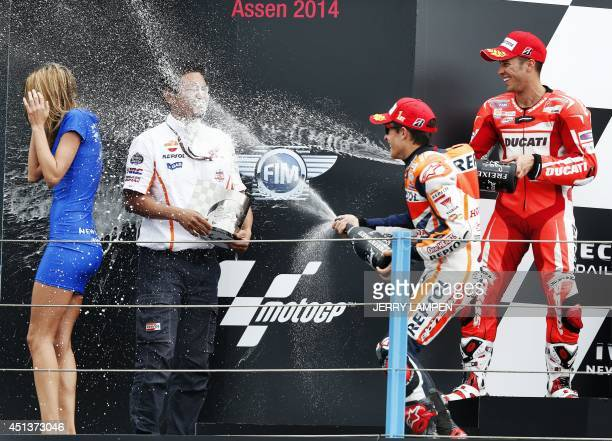 MotoGP rider Marc Marquez from Spain celebrates on the podium with Andrea Dovizioso from Italy after he won the Motorcycling Grand Prix of Assen at...