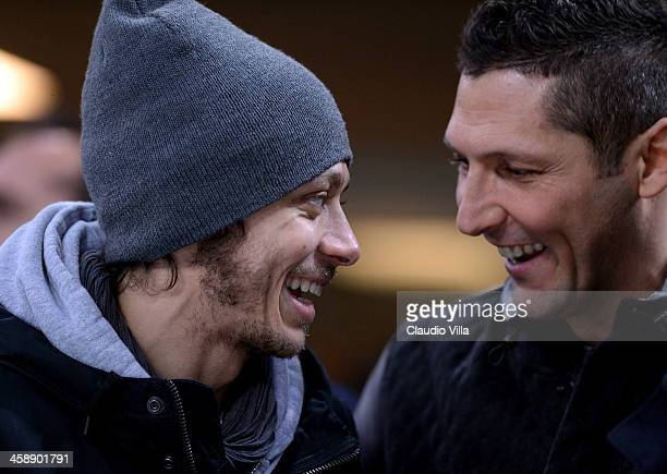 MotoGP rider Valentino Rossi attends the Serie A match between FC Internazionale Milano and AC Milan at San Siro Stadium on December 22 2013 in Milan...
