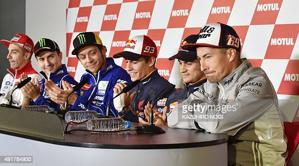 MotoGP riders Andrea Iannone of Italy Jorge Lorenzo of Spain Valentino Rossi of Italy Marc Marquez of Spain and Dani Pedrosa of Spain applaud Nicky...