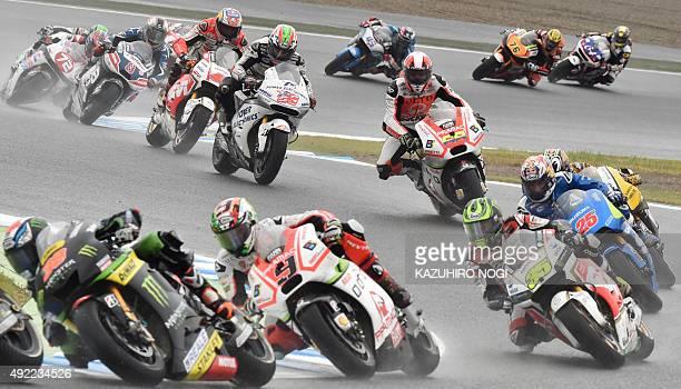 MotoGP riders compete during the Japanese Grand Prix in Motegi Tochigi prefecture on October 11 2015 AFP PHOTO / KAZUHIRO NOGI / AFP / KAZUHIRO NOGI