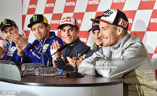 MotoGP riders Jorge Lorenzo of Spain Valentino Rossi of Italy Marc Marquez of Spain and Dani Pedrosa of Spain clap for Nicky Hayden of the US who...