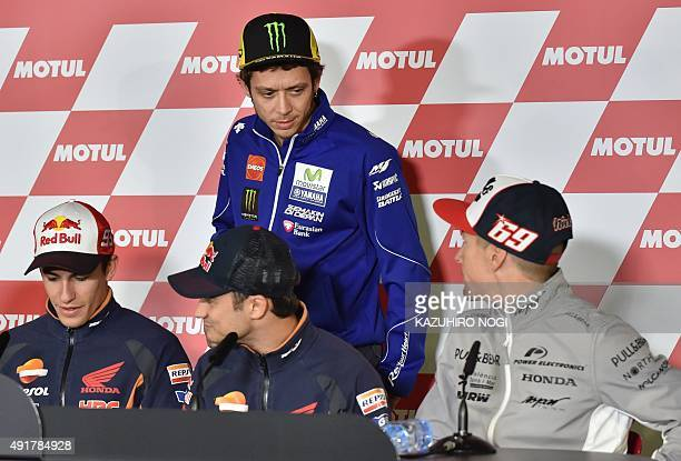 MotoGP riders Valentino Rossi of Italy chats with Nicky Hayden of the US who announced his retirement for the end of this season before the preevent...