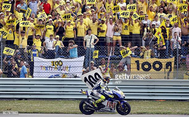 MotoGP world champion Valentino Rossi of Italy celebrates his 100th grand prix victory at the Dutch TT race at Assen on June 27 2009 Rossi won the...