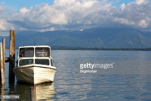 Motor boat at the pier, Chiemsee, Bavaria : Stock Photo