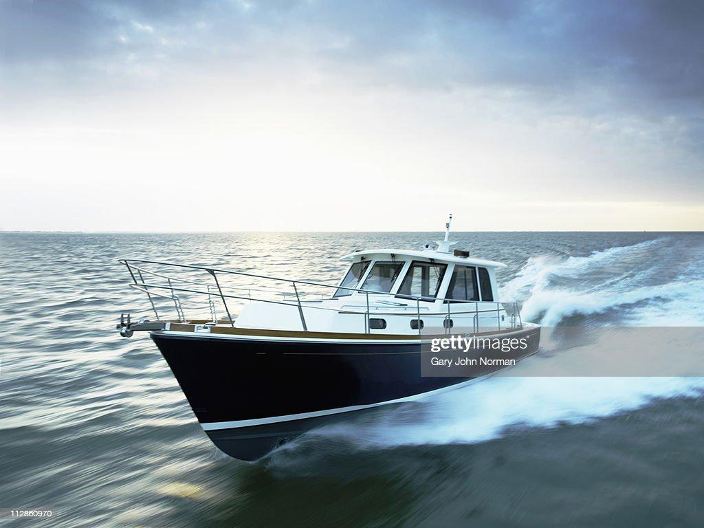 Motor boat powering through the sea