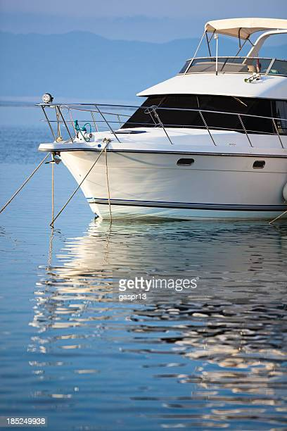 motor boat reflecting on the water surface