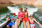 Group of happy, laughing friends or family vacationing together on a boat.   with Friends