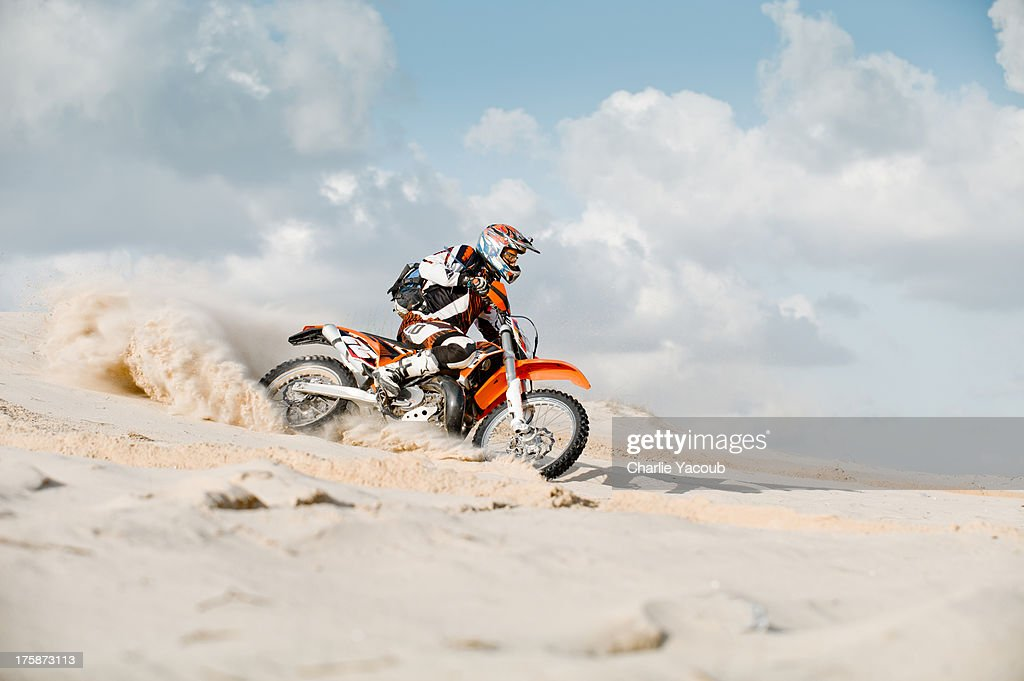 motor cross riding over sand