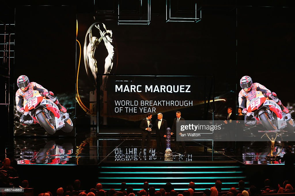 Motor cyclist <a gi-track='captionPersonalityLinkClicked' href=/galleries/search?phrase=Marc+Marquez&family=editorial&specificpeople=5409395 ng-click='$event.stopPropagation()'>Marc Marquez</a> accepts his Laureus World Breakthrough of the Year award from Laureus Academy member Giacomo Agostini and <a gi-track='captionPersonalityLinkClicked' href=/galleries/search?phrase=Mick+Doohan&family=editorial&specificpeople=604096 ng-click='$event.stopPropagation()'>Mick Doohan</a> during the 2014 Laureus World Sports Award show at the Istana Budaya Theatre on March 26, 2014 in Kuala Lumpur, Malaysia.