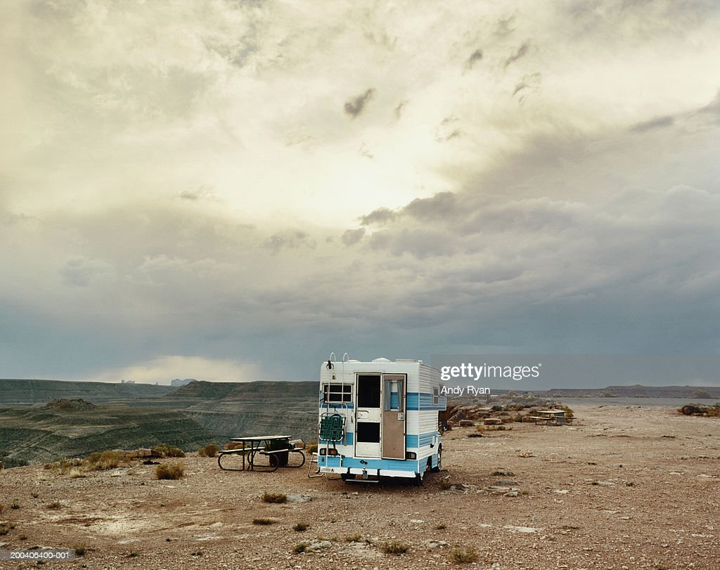Motor home parked in picnic area on plateau in desert landscape : Stock Photo