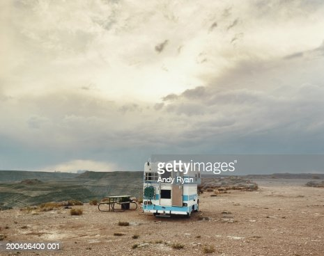 Motor home parked in picnic area on plateau in desert landscape : Photo