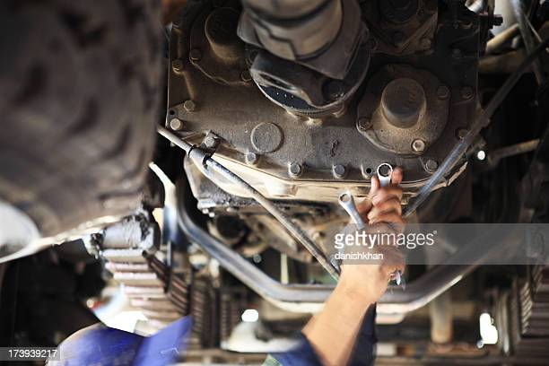Motor Mechanic below a Heavy goods Vehicle