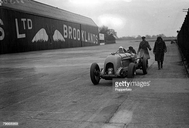 Motor Racing 16th April Racing motorist Captain HRS Birkin about to attempt a new lap record in his Bentley car on the track at the Brooklands Surrey...