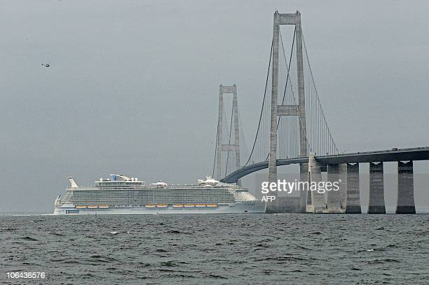 Motor Ship called The Allure of the Seas cruise ship passes under the Store Belt Bridge connecting Danish islands of Fuenen and Zealand on October 30...
