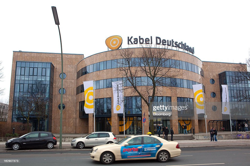 Motor traffic is seen passing the headquarters of Kabel Deutschland Holding AG, the German cable operator in Berlin, Germany, on Friday, March 1, 2013. Vodafone Group Plc has put on hold plans to approach Kabel Deutschland Holding AG about a takeover bid after leaks of a potential offer complicated internal discussions, according to three people familiar with the matter. Photographer: Krisztian Bocsi/Bloomberg via Getty Images