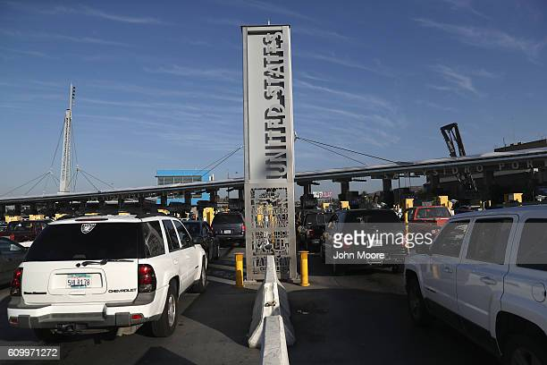Motor vehicle traffic waits to cross the USMexico border from Tijuana Mexico on September 23 2016 in San Ysidro California More than 10000 people...