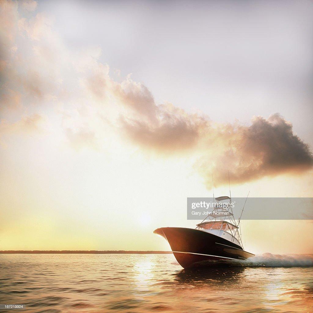Motor yacht powering through calm water