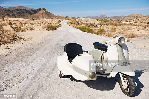 Motorbike and side car on the road