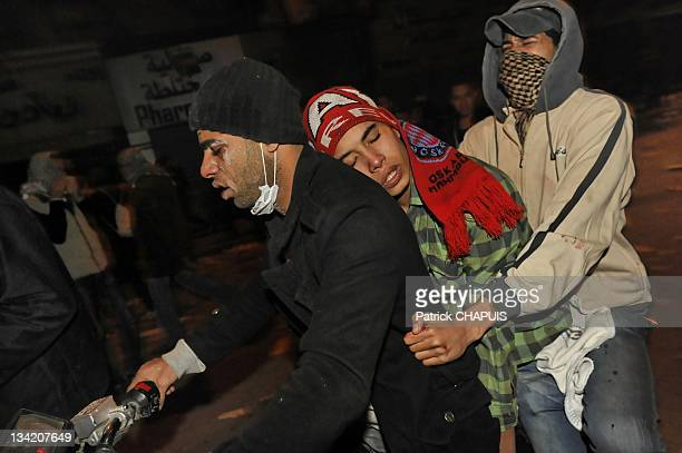 A motorbike carries injured protestors to a medical center in Tahrir Square during clashes with police on November 21 2011 in Cairo Egypt Thousands...