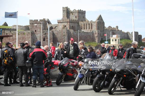 Motorbike fans gather along the promenade with Peel castle in the background on June 7 2009 in Peel Isle Of Man The annual TT race is one of the...
