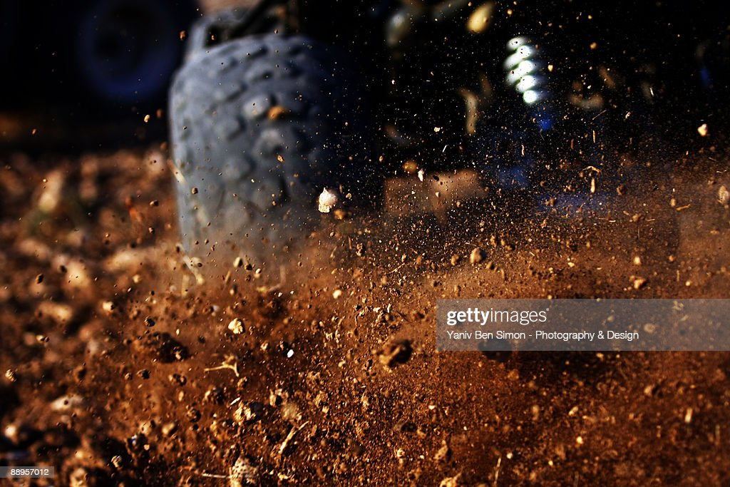 Motorbike on dirt road, close up