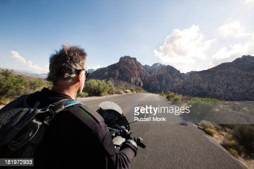 A motorbike rider on a scenic road