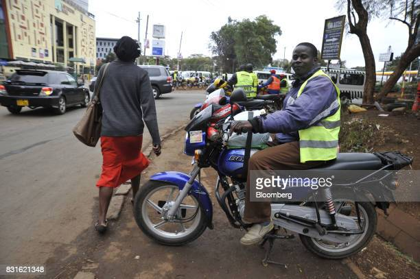 A motorbike taxi driver waits for customers at a road intersection in Nairobi Kenya on Tuesday Aug 15 2017 Kenyan opposition leader Raila Odingas...