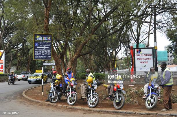 Motorbike taxi drivers wait for customers at a road intersection in Nairobi Kenya on Tuesday Aug 15 2017 Kenyan opposition leader Raila Odingas...