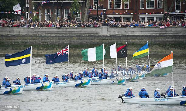 Motorboats flying the flags of Commonwealth nations make their way down the River Thames during the Diamond Jubilee Pageant in London on June 3 2012...