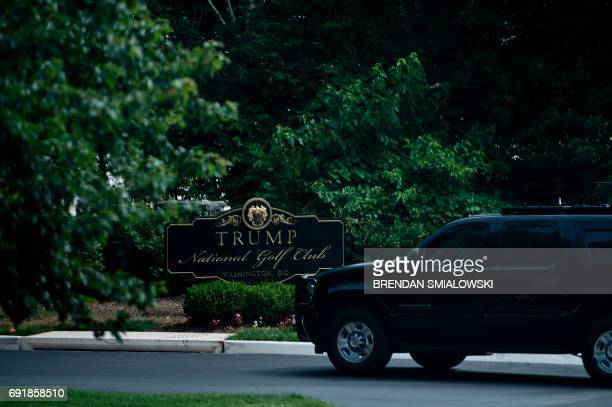 A motorcade with US President Donald Trump arrives at the Trump National Golf Club on June 3 2017 in Sterling Virginia / AFP PHOTO / Brendan...