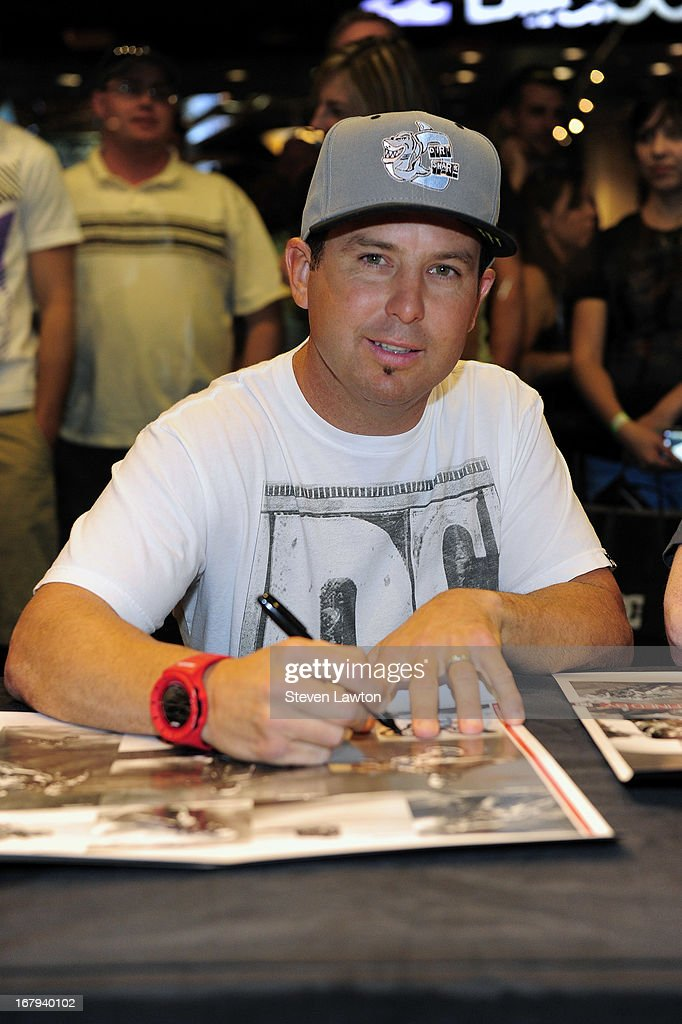 Motorcross rider Jeremy McGrath poses while he signs autographs during a DC Moto Team appearance in celebration of the 2013 AMA Supercross Finals at the DC Shoes store at Planet Hollywood Resort & Casino on May 2, 2013 in Las Vegas, Nevada.