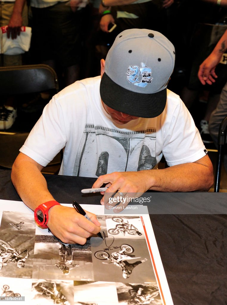 Motorcross rider Jeremy McGrath signs autographs during a DC Moto Team appearance in celebration of the 2013 AMA Supercross Finals at the DC Shoes store at Planet Hollywood Resort & Casino on May 2, 2013 in Las Vegas, Nevada.