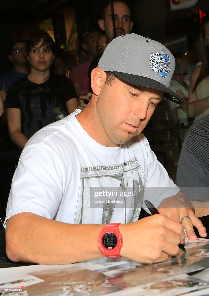 Motorcross rider <a gi-track='captionPersonalityLinkClicked' href=/galleries/search?phrase=Jeremy+McGrath&family=editorial&specificpeople=249986 ng-click='$event.stopPropagation()'>Jeremy McGrath</a> signs autographs during a DC Moto Team appearance in celebration of the 2013 AMA Supercross Finals at the DC Shoes store at Planet Hollywood Resort & Casino on May 2, 2013 in Las Vegas, Nevada.