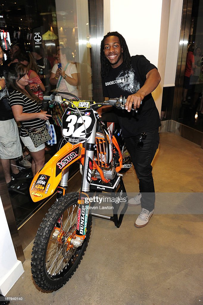 Motorcross rider Malcolm Stewart poses with his dirt bike before he signs autographs during a DC Moto Team appearance in celebration of the 2013 AMA Supercross Finals at the DC Shoes store at Planet Hollywood Resort & Casino on May 2, 2013 in Las Vegas, Nevada.