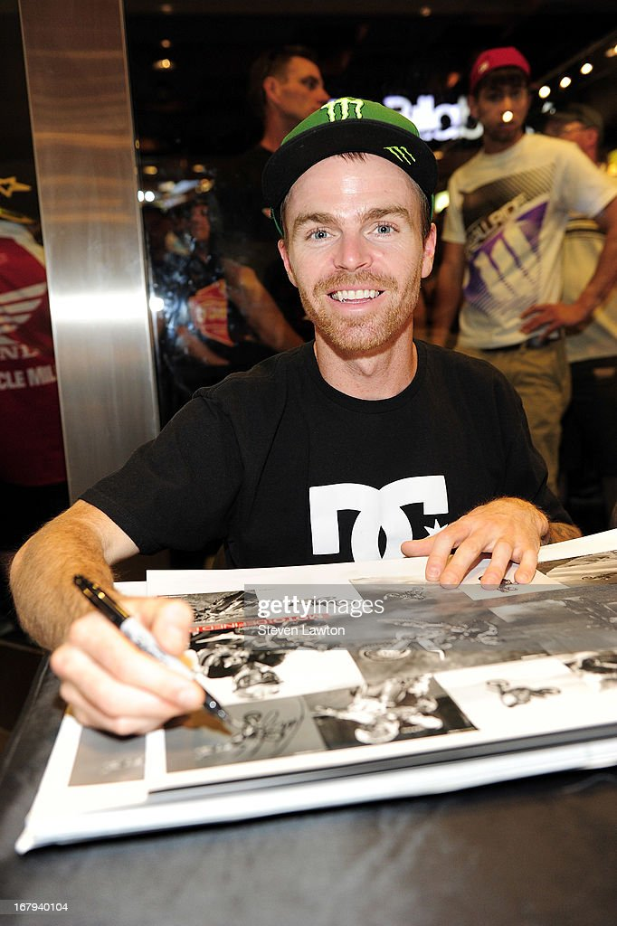 Motorcross rider Nate Adams poses while he signs autographs during a DC Moto Team appearance in celebration of the 2013 AMA Supercross Finals at the DC Shoes store at Planet Hollywood Resort & Casino on May 2, 2013 in Las Vegas, Nevada.