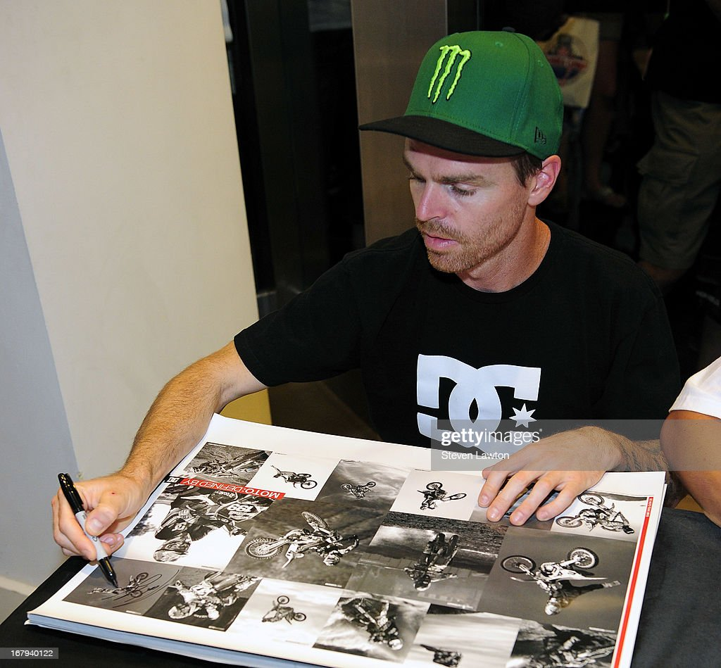 Motorcross rider Nate Adams signs autographs during a DC Moto Team appearance in celebration of the 2013 AMA Supercross Finals at the DC Shoes store at Planet Hollywood Resort & Casino on May 2, 2013 in Las Vegas, Nevada.