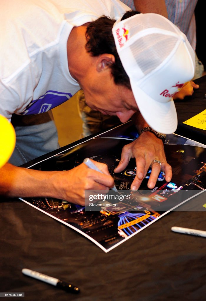 Motorcross rider <a gi-track='captionPersonalityLinkClicked' href=/galleries/search?phrase=Robbie+Maddison&family=editorial&specificpeople=636450 ng-click='$event.stopPropagation()'>Robbie Maddison</a> signs autographs during a DC Moto Team appearance in celebration of the 2013 AMA Supercross Finals at the DC Shoes store at Planet Hollywood Resort & Casino on May 2, 2013 in Las Vegas, Nevada.