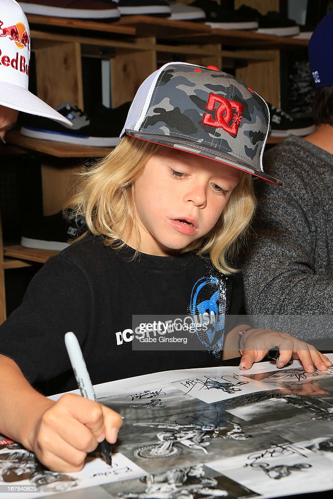 Motorcross rider Ryder DiFrancesco signs autographs during a DC Moto Team appearance in celebration of the 2013 AMA Supercross Finals at the DC Shoes store at Planet Hollywood Resort & Casino on May 2, 2013 in Las Vegas, Nevada.