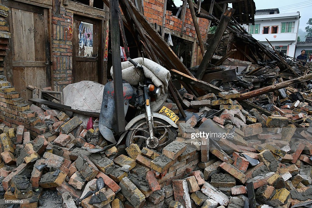 Motorcycle and rubble from a collapsed building after a strong earthquake hit Southwest China's Sichuan Province on April 23, 2013 in Longmen township of Lushan county, China. A magnitude 7 earthquake hit China's Sichuan province on April 20 claiming over 190 lives and injuring thousands.