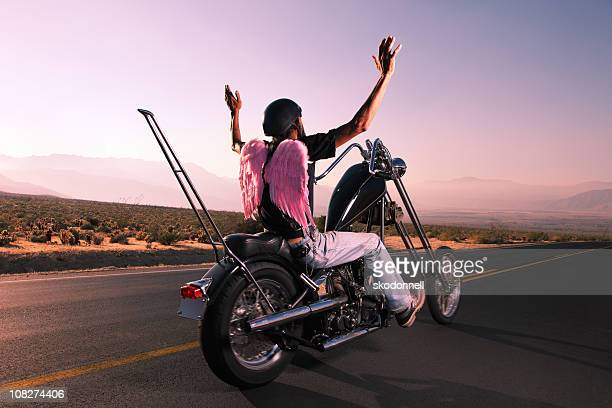 Motorcycle Biker on the Open Road with Angel Wings