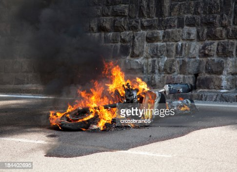 motorcycle burning after accident