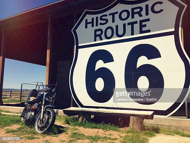 Motorcycle By Historic Route 66 Sign Board